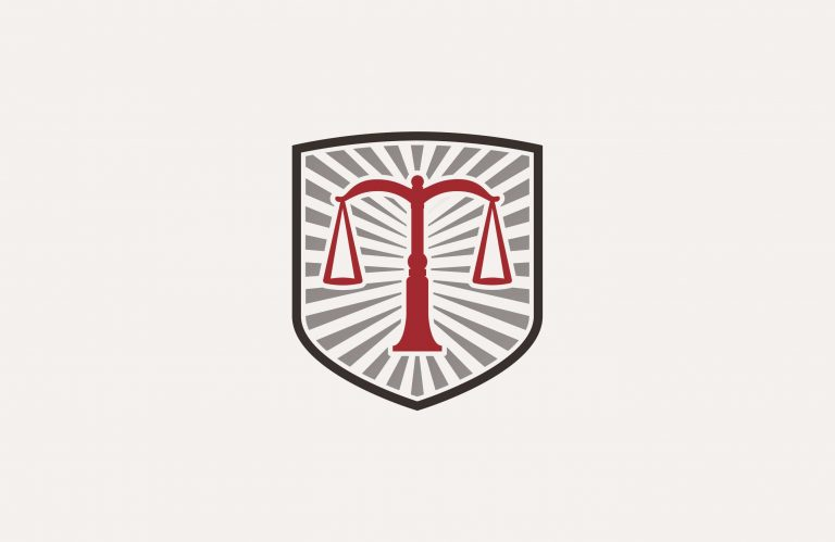 TCNF's logo with the scales of justice