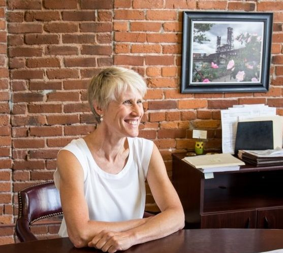 Cynthia Newton, a Portland personal injury attorney who specializes in medical malpractice cases, sitting at her desk at Thomas, Coon, Newton & Frost answering commonly asked questions about medical malpractice cases and what people should do if they believe medical malpractice happened to them.