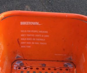 A list of rules printed on all BIKETOWN bikes: Yield for people walking, obey traffic lights and laws, walk bikes on sidewalk, don't bike on rail tracks, have fun! But these rules don't accurately represent Oregon bike law.