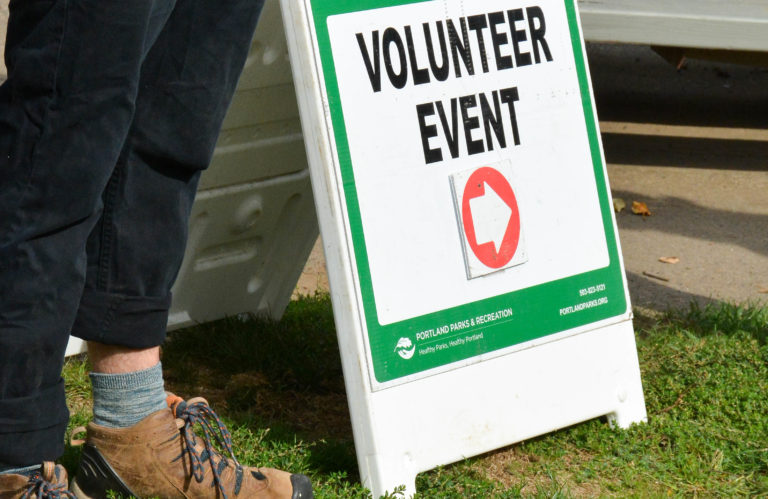"Sign saying ""volunteer event""; this sign was posted at Sellwood Park during Thomas, Coon, Newton & Frost's recent Community Service Day with Portland Parks and Recreation"