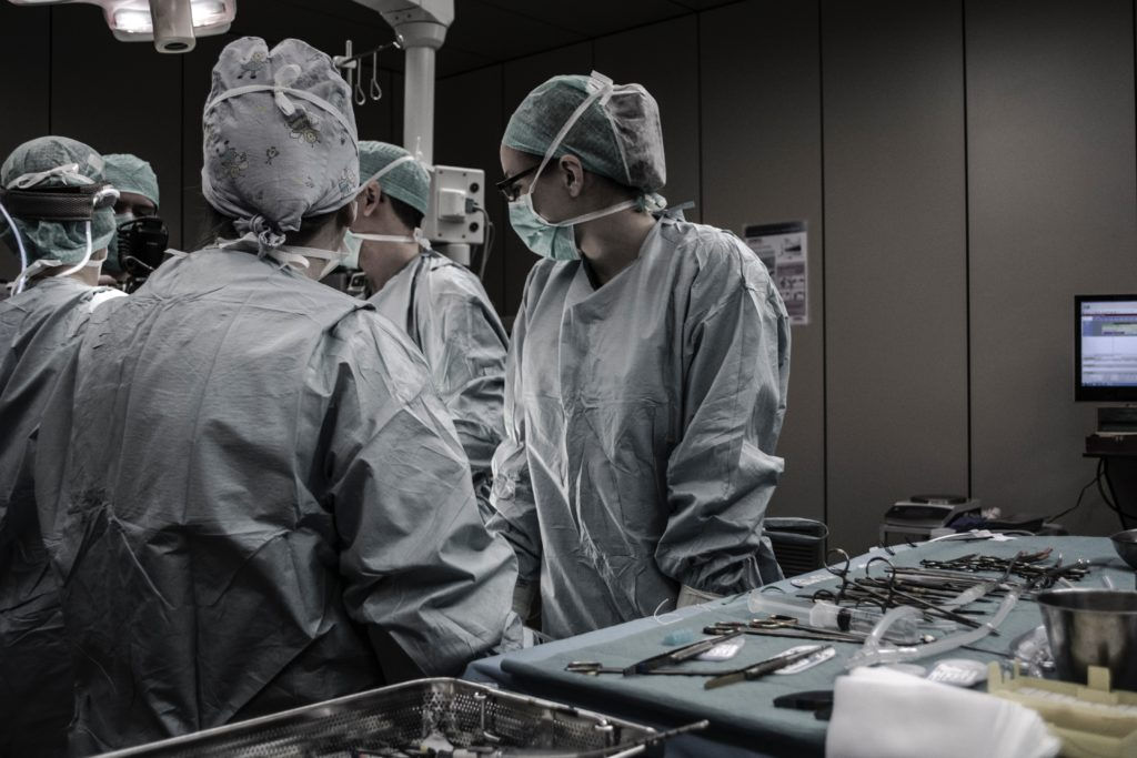 image of a surgical team in an operating room
